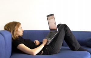 Woman on couch with laptop (credit len-k-a at sxc.hu)