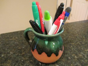 Coffee mug used as pencil holder