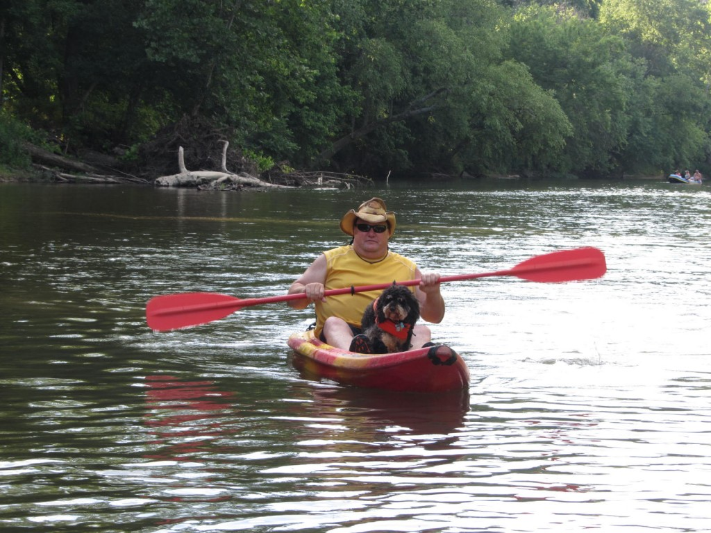 Man and dog in a kayak