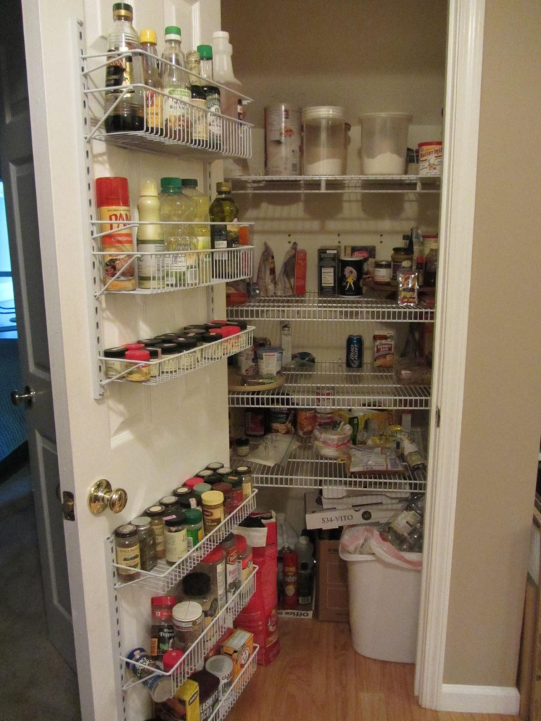 Stocked pantry with door shelving