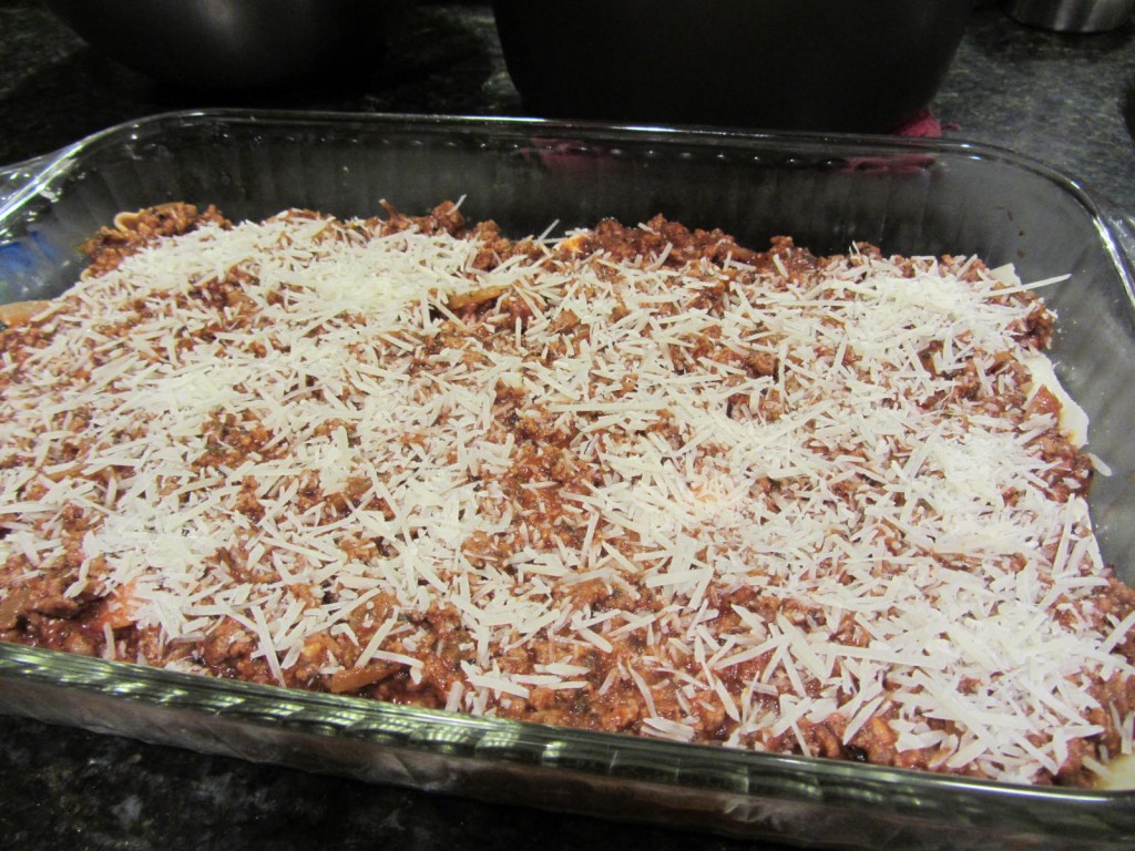 Lasagna covered in parmesan cheese