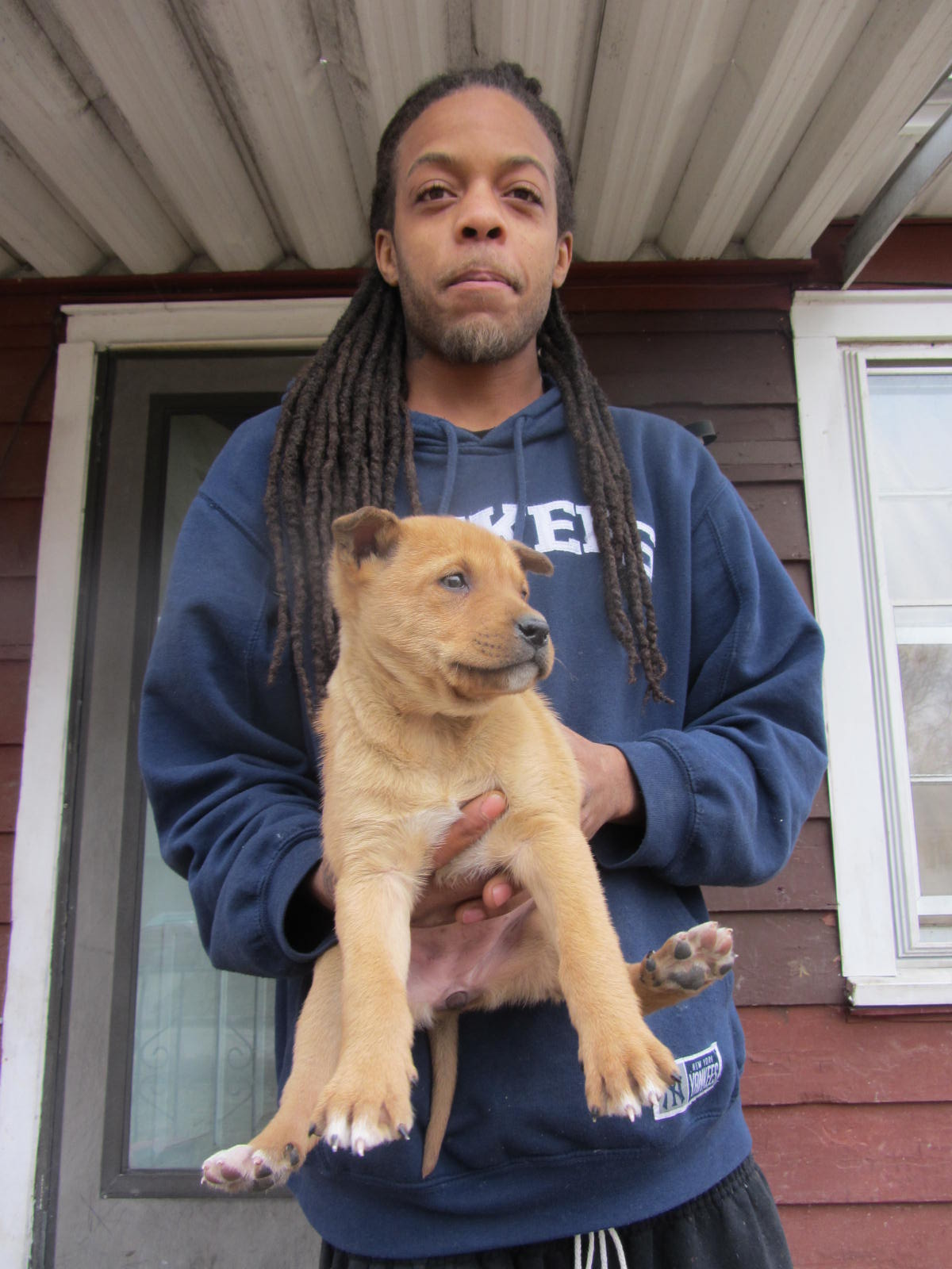 East St. Louis man with puppy