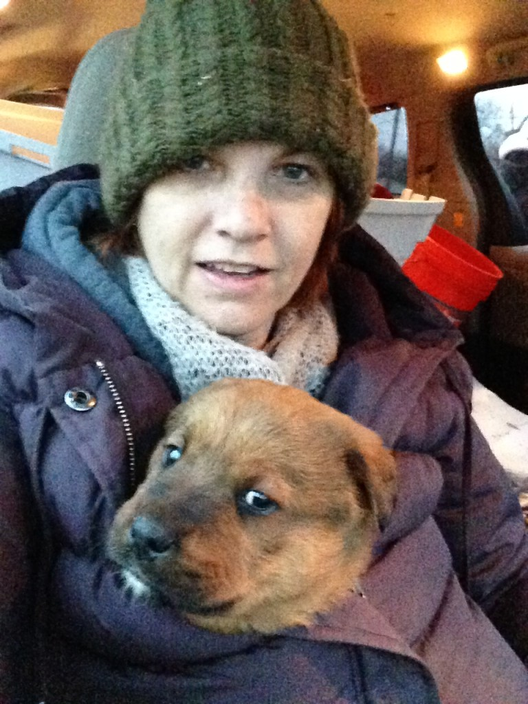 Karen Goodman holding rescued puppy